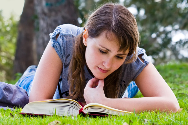 woman reading reiki course materials